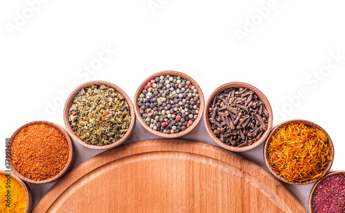 set spices in a wooden bowl - 77997498