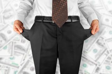 man showing empty pockets