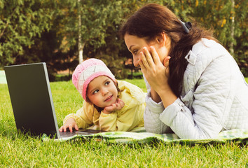 Mother and daughter working at the notebook