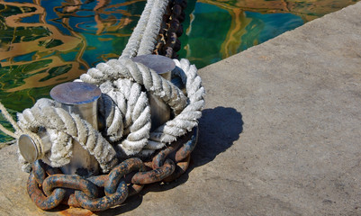 Bollard with the marine ropes and chains ship.
