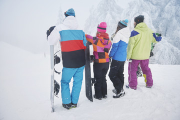 Group of friends on snowboard