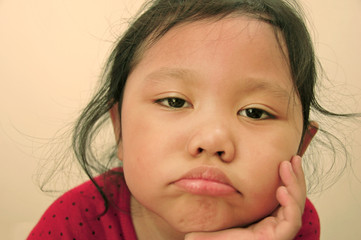 Cute little girl with boring face