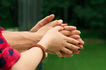 Female and male hands in hug