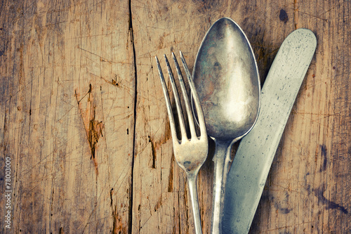 Fork, spoon and knife closeup - 78003000