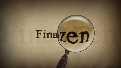 Schriftzug Finanzen mit Lupe