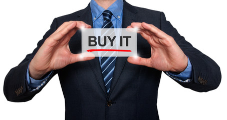 Businessman in black suit holding buy it sign. White background