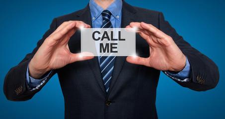 Call me. Businessman shows business card. Blue Background