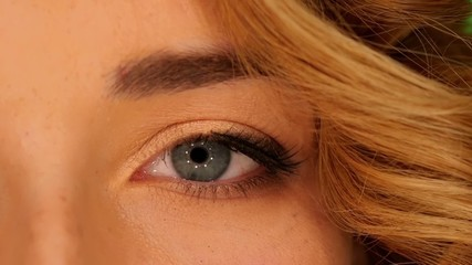 Beautiful grey eye of young attractive blond woman, close up