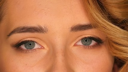 Beautiful brown eyes of young blond woman, close up