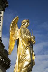 golden staue of virgin mary