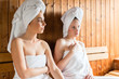 women in wellness spa enjoying sauna infusion