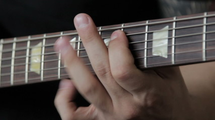 Guitarist play on electric guitar