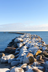Old breakwater in cold day.