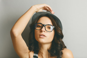Beautiful girl in a hat and glasses.