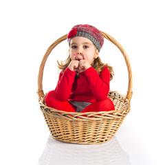 Surprised cute baby inside basket