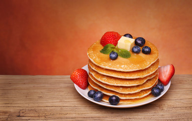 Stack of pancakes with fresh blueberry, strawberry