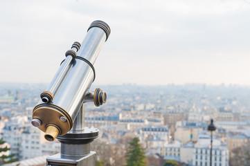 Tourist telescope over viewing Paris  at Sacre Coeur