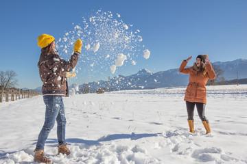 Girls Having Fun In The Snow
