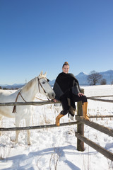 Young Woman With White Horse In Winter