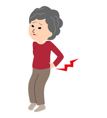 An elderly woman suffering from a back pain