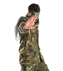 Soldier making stop sign over white background