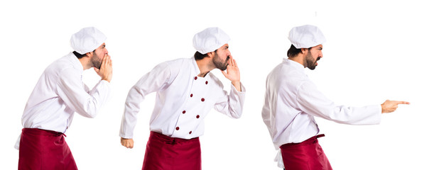 Chef shouting and pointing over white background