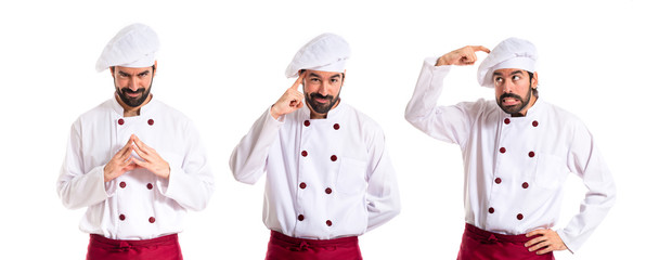 Chef thinking over white background