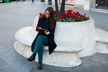 Elegant business woman working with digital tablet pc outdoors