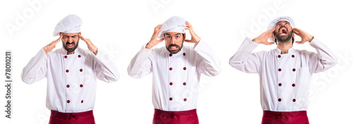 frustrated chef over white background - 78010211
