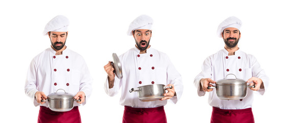 Surprised chef holding a pot