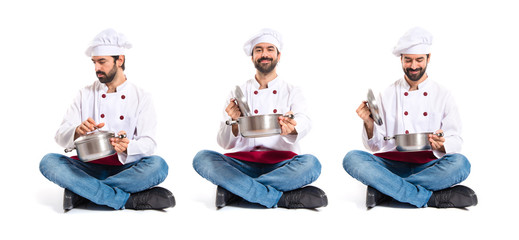 Chef holding pot