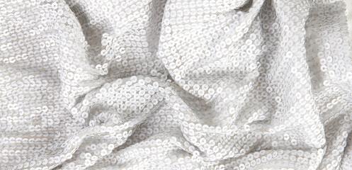 White shiny squin textile background