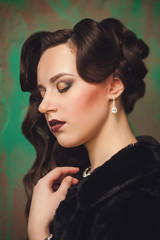 retro portrait of a woman with closed eyes and bright makeup