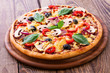 Pizza with seafood on wood table - 78013059