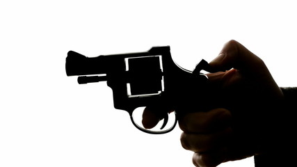 man shooting a handgun, real time, isolated, studio lighting