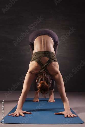 Mature woman practicing yoga on the floor плакат