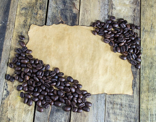 Old paper and coffee beans on wooden table