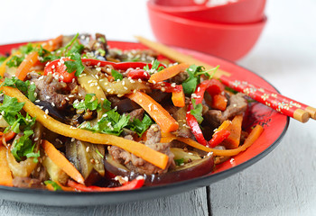 Hot salad with eggplant, beef and pepper. Asian cuisine