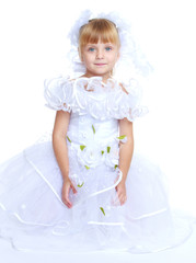 Beautiful little girl in a long white princess ball gown.