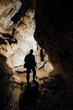 dark cave with explorer silhouette