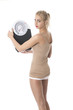 Model Released. Attractive Young Woman with Bathroom Scales