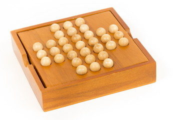 Peg solitaire wooden puzzle, isolated image