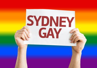 Sydney Gay card with rainbow flag background