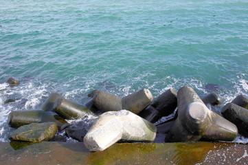 Broken tetrapod on breakwater