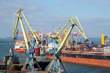Yellow cranes and container ship in Odessa sea port,Ukraine