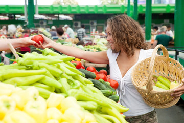 Young Woman Buying Tomato at Grocery Market