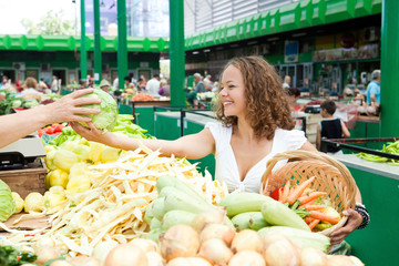 Eating Series: Young Woman Buying Cabbage at Grocery Market