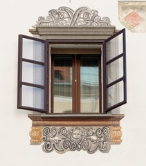 Window of old house in Ljubljana, Slovenia, with murals