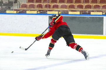 Ice Hockey - Player makes a slap shot