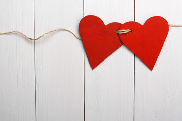Two red hearts tied together